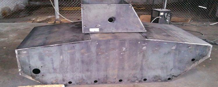 Volunteers assemble tank body
