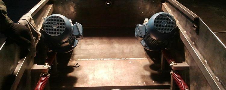 Mechanics install main engines in tank