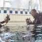 Television journalists cover preparations for School of Military Divers